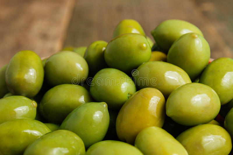Green olives background. Top view. Green olives background. Top viewitalian stock image