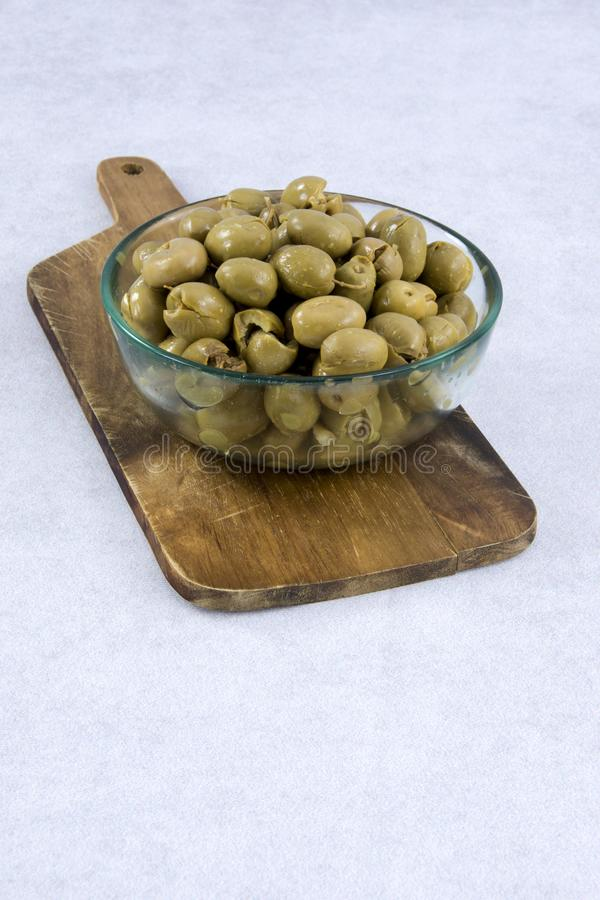 Green olives in a bowl stock images
