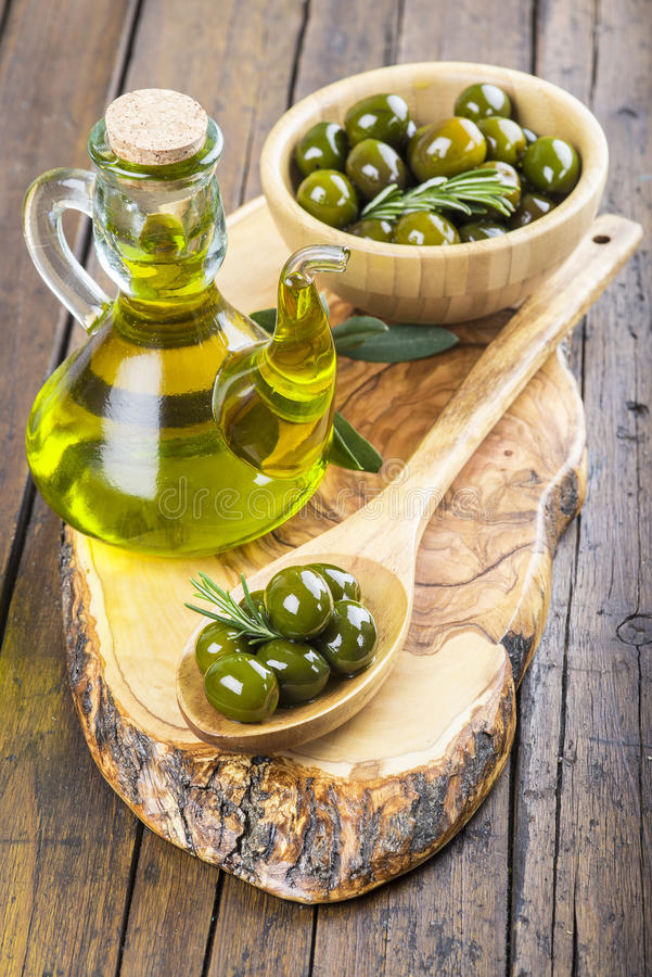 Green olives and extra olive oil stock photo