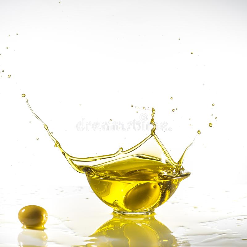 Green olives and extra virgin olive oil with splash royalty free stock photo