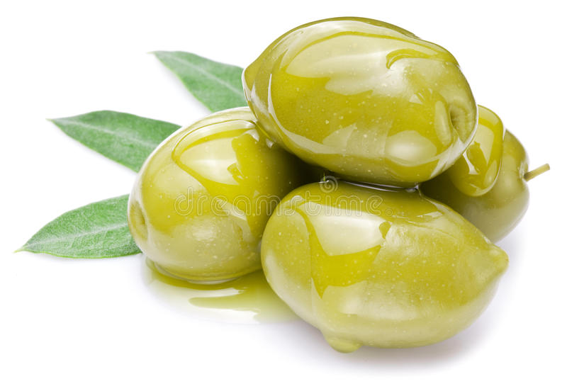 Green olives with leaves stock photo