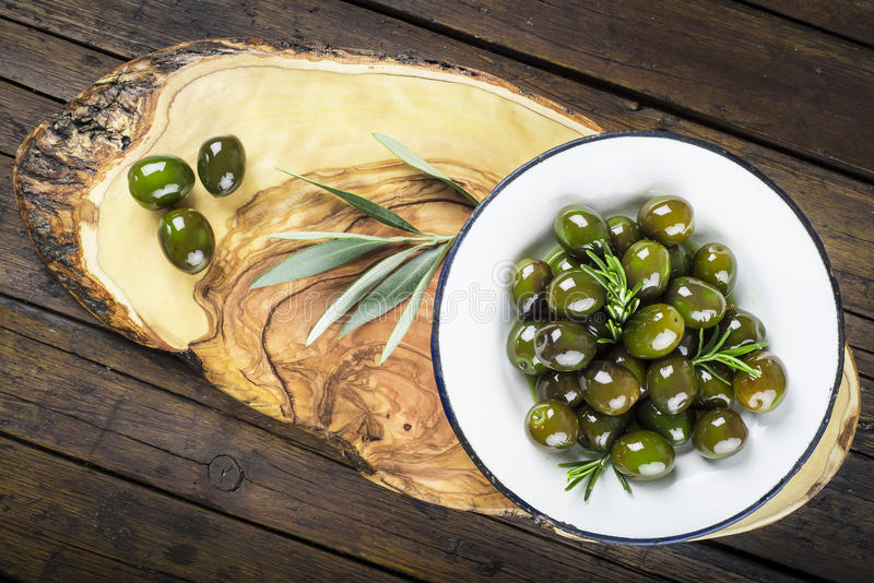 Green olives with olive oil and rosemary royalty free stock image