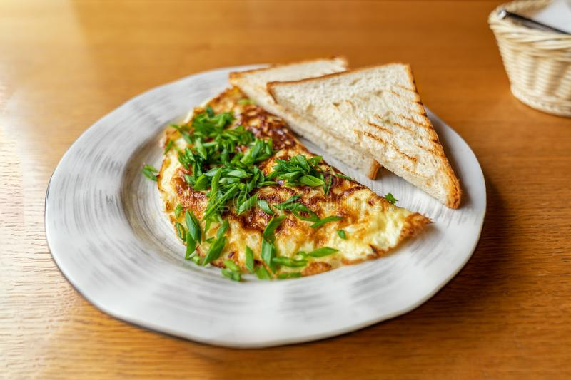 Green onion Omelette with Bread Toasts on Plate. delicious, easy and popular Breakfast royalty free stock images