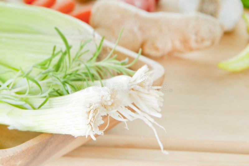 Green onions on cutting board