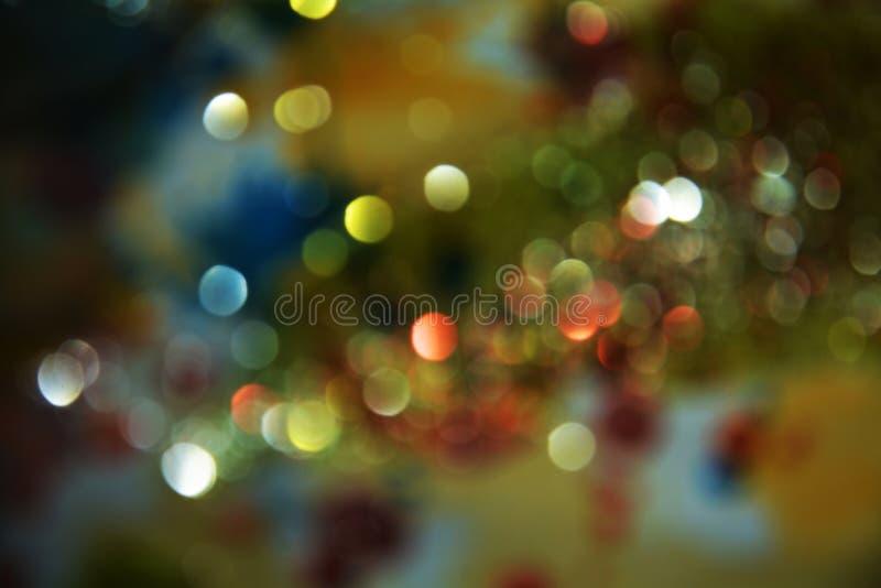 Green orange blue bokeh, circular lights colorful hues, background, bokeh. Green orange blue bokeh, vivid background, colorful pastel circular lights in circular royalty free stock images