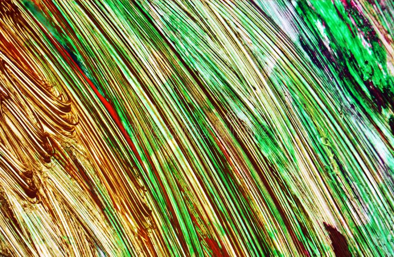 Green red orange paint blurred abstract vivid background, texture and strokes of brush royalty free stock photos