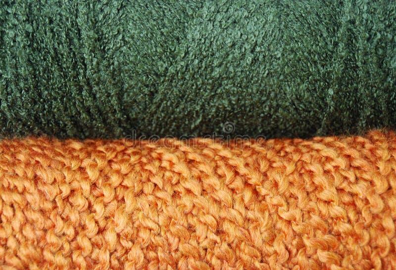 Green and orange yarn background stock photo