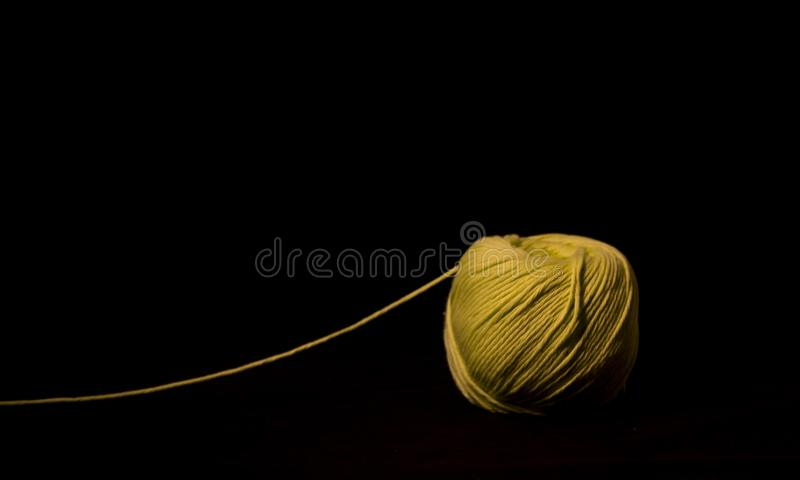 Green yarn thread isolated on black background stock images