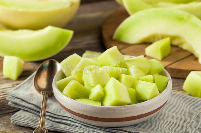 Green Organic Honeydew Melon. Cut in a Bowl stock images