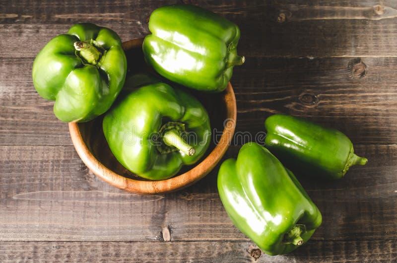 green organic paprika on wooden bowl/Fresh green organic paprika royalty free stock images