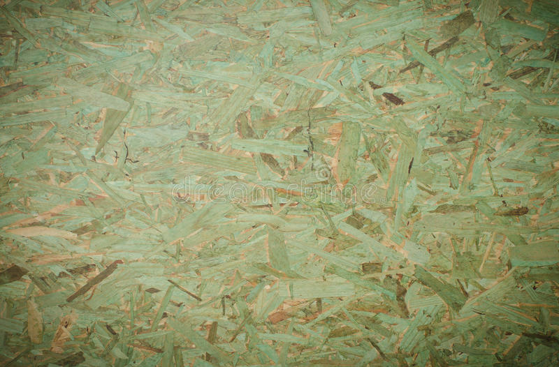 Green OSB background (Oriented Strand Board). OSB background (Oriented Strand Board royalty free stock image