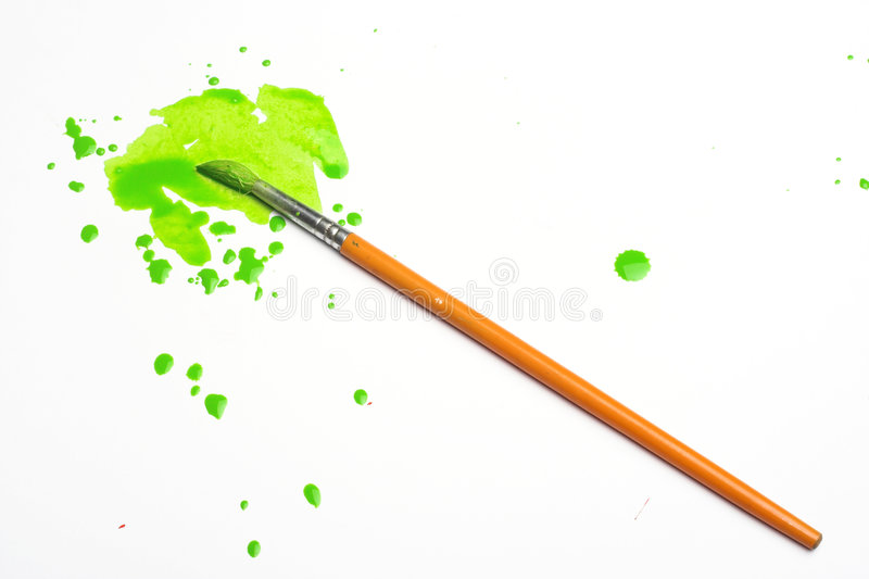 Green paint and brush. Splashes of green paint and brush stock photo
