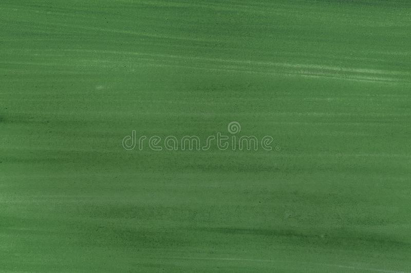 Green paint brush stroke texture background on paper. Watercolor texture for creative wallpaper or design art work. Pastel colors. Green paint brush stroke royalty free stock image