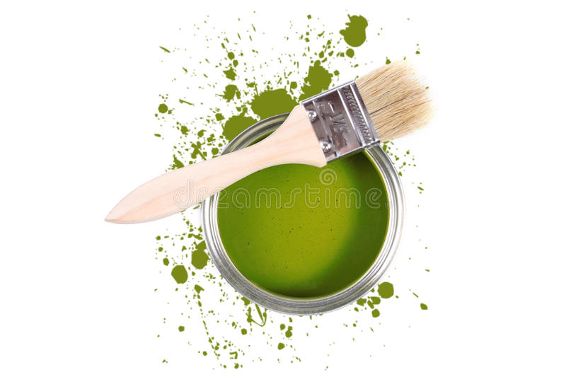 Green paint can with brush and color stains royalty free stock photo
