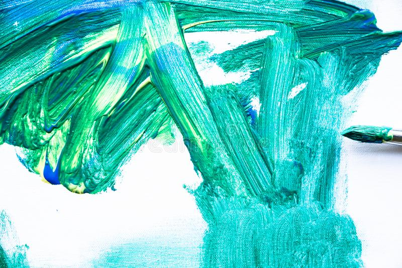 Green paint texture, abstract background, brush strokes on canvas. Paint texture background, hand drawn green painting, brush strokes on canvas , green colored royalty free stock photography