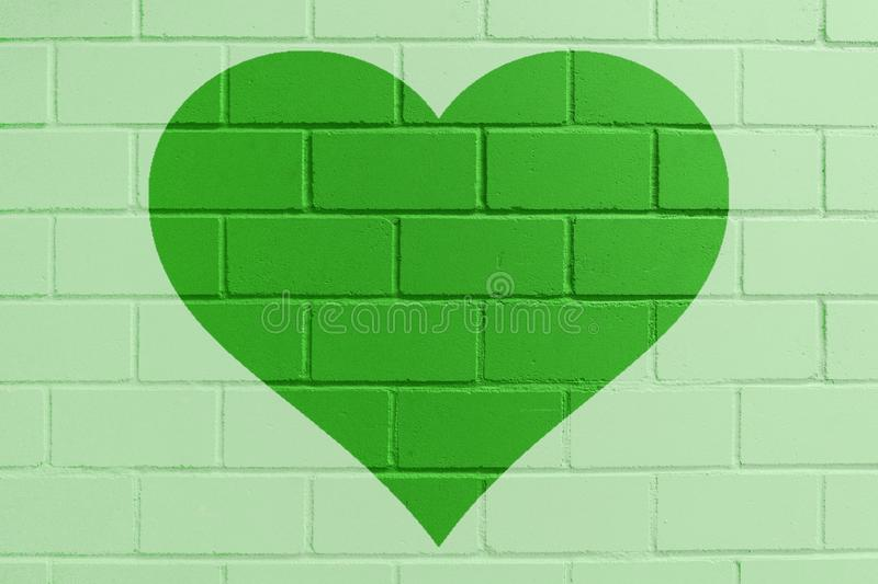 Green painted brick wall with heart royalty free stock photos