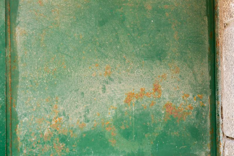 Green painted metal surface with a points of rust.  royalty free stock photo