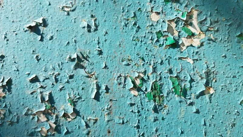 Green painted wall background with flaking paint texture closeup royalty free stock photos