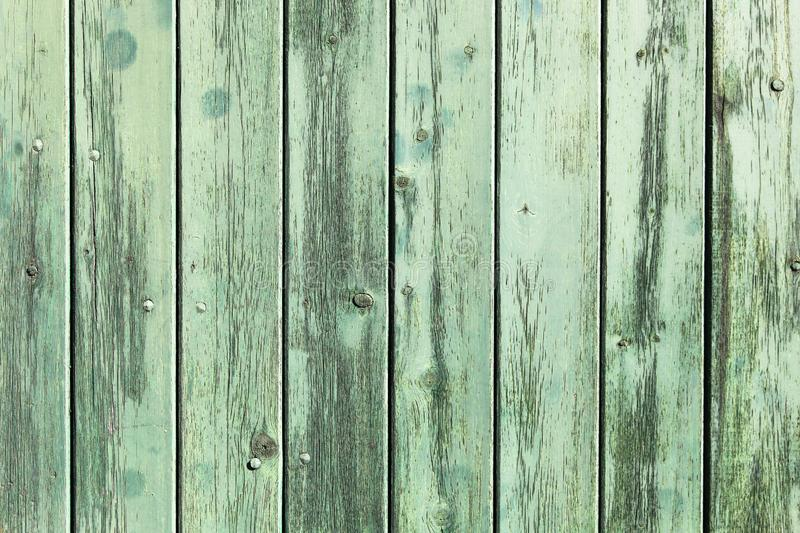 Green painted wooden wall plank perpendicular to the frame simple blue paint timber old grungy wood surface texture background. Green painted wooden wall plank royalty free stock images