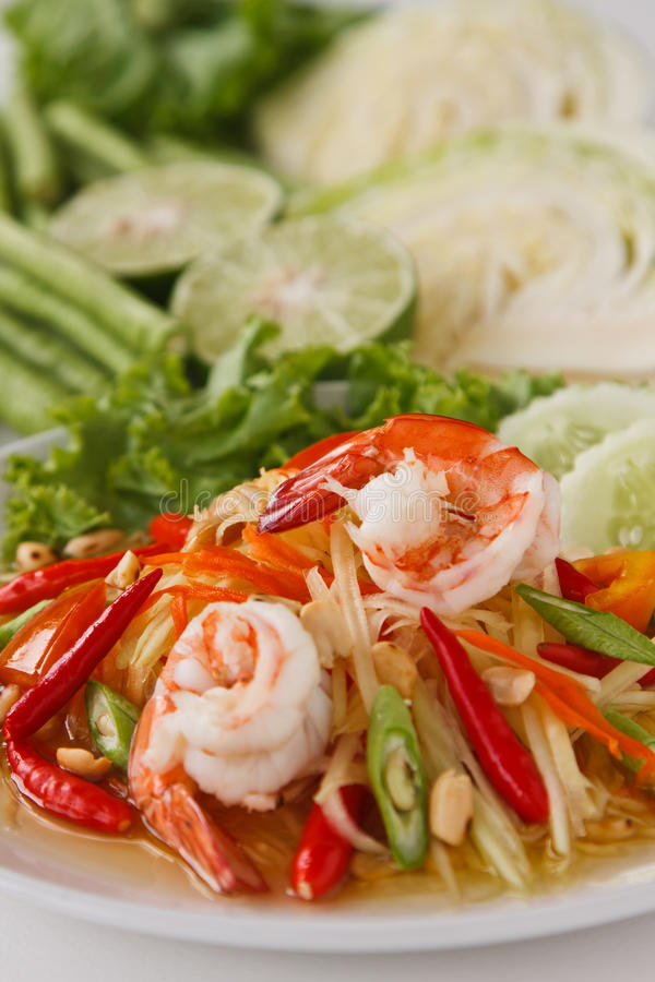 Green papaya salad. Som Tam (Green Papaya Salad) is a very popular traditional and modern thai food stock image