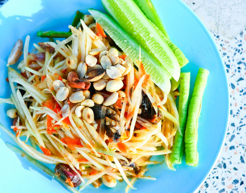 Green papaya salad with crab. Spicy papaya salad with crab from Thailand stock photo
