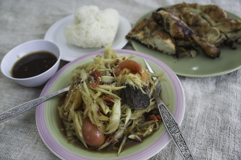 Green papaya salad, grilled chicken royalty free stock photography