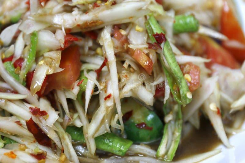 Green papaya salad, papaya salad with salted crab and fermented Fish, spicy papaya salad with raw crab, sliced green papaya salad stock photography