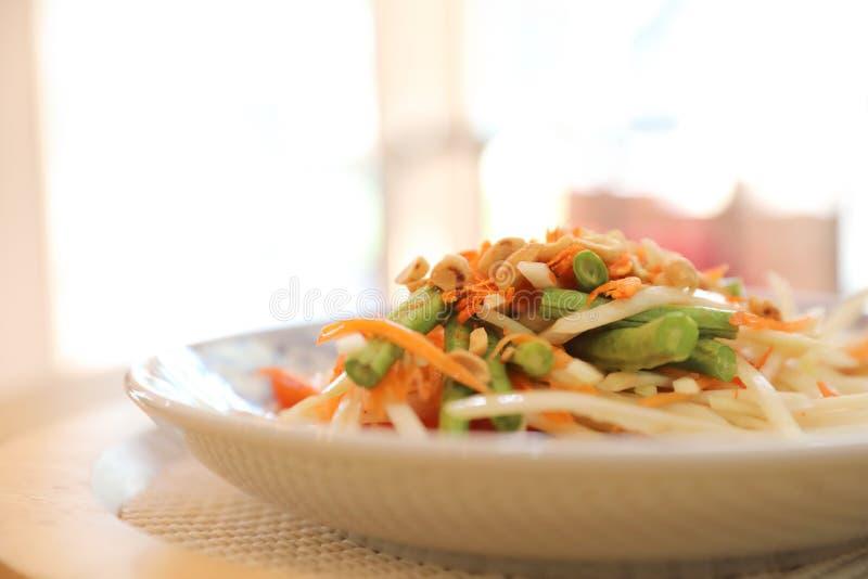 Green papaya salad or Som tam in Thai street food. In closeup royalty free stock images