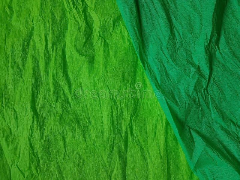 Green background silk surface empty blank sheets vivid colors. Green paper background silk surface empty blank sheets vivid colors orange stock photo