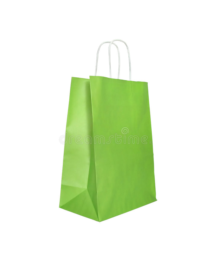Green paper bag. Green paper shopping bag, isolated on white royalty free stock image