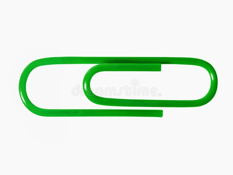 A green paper clip. On white royalty free stock image