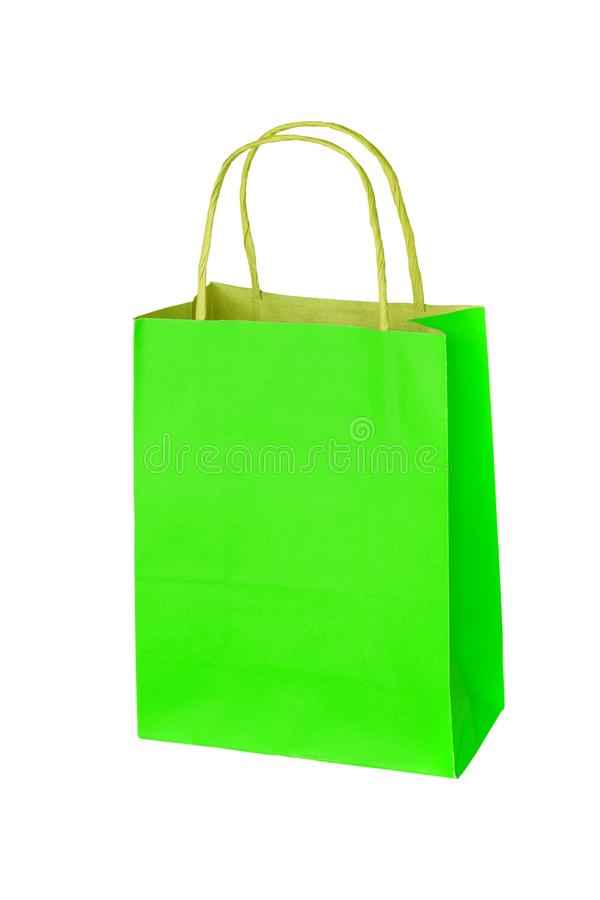 Green paper shopping bag isolated on white background.  stock photos