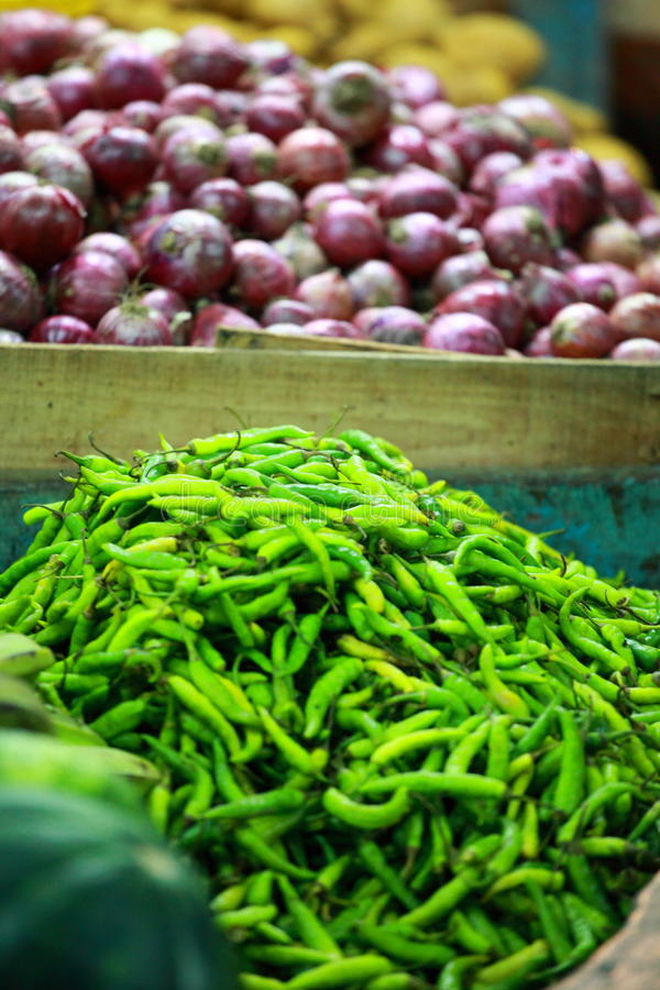 Green paprica in traditional vegetable market in India. royalty free stock photos
