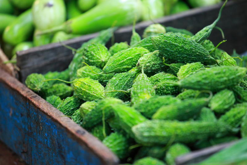Green paprica in traditional vegetable market in India. stock photo