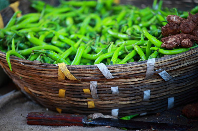 Green paprica in traditional vegetable market in India. royalty free stock image