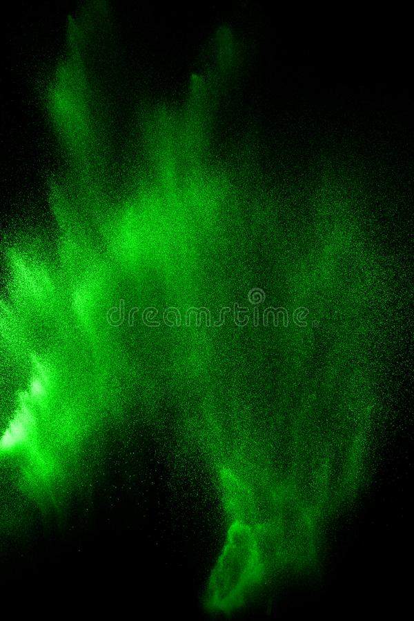 Green particles explosion on black background. Color dust splash use for abstract background stock photography