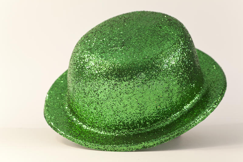 Green party hat. Green glittery derby style party hat, isolated on a white background royalty free stock photos
