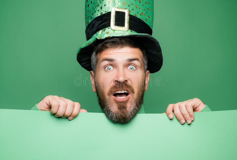 Green patricks background. Man in Patrick`s suit smiling. Green patricks background. Man in Patrick`s suit smiling stock photo