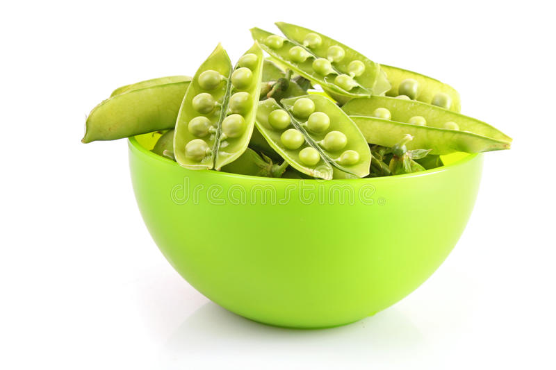 Green pea in plate royalty free stock images