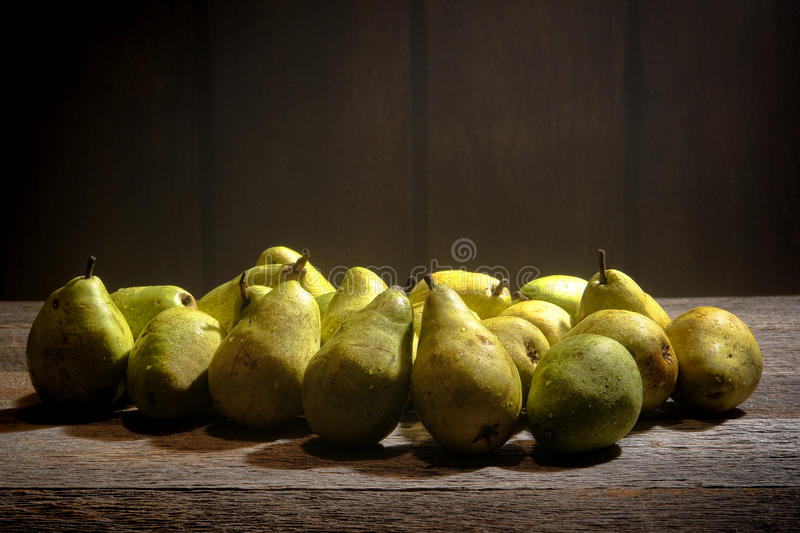 Download Green Pears On Old Country Farm Stand Wood Table Stock Photo - Image: 32837166