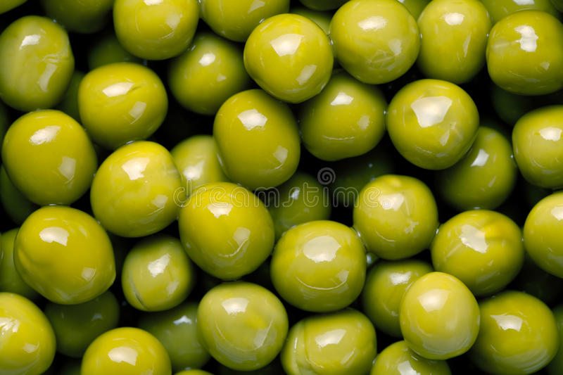 Green Peas. Canned green peas close up for background stock image