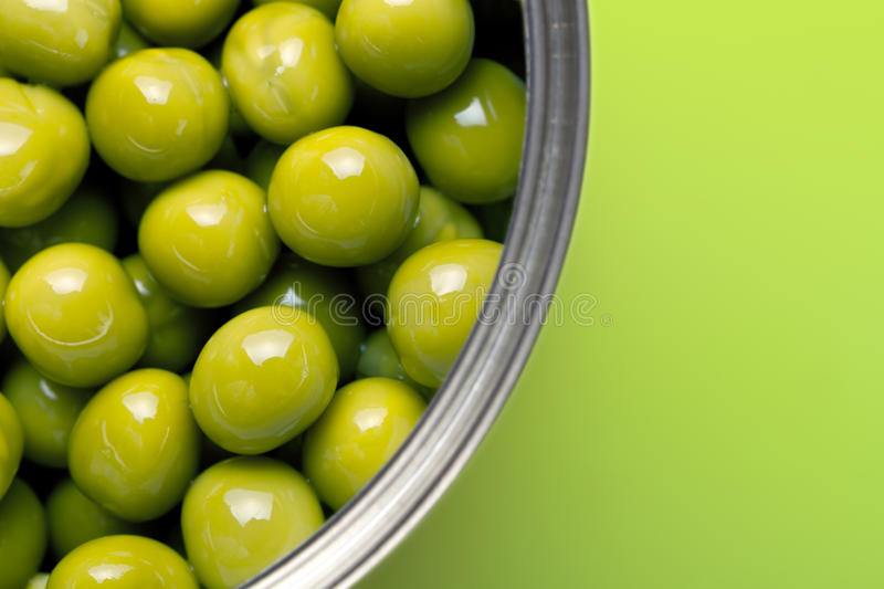 Green Peas. Canned peas on green background. Macro shot with copy space royalty free stock photography