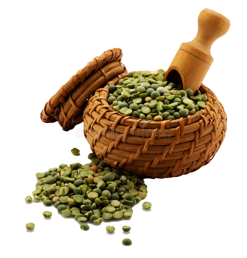 Green peas in a basket. Isolated royalty free stock images