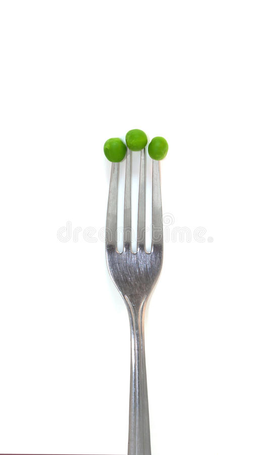 Green Peas on The End of A Fork stock photography