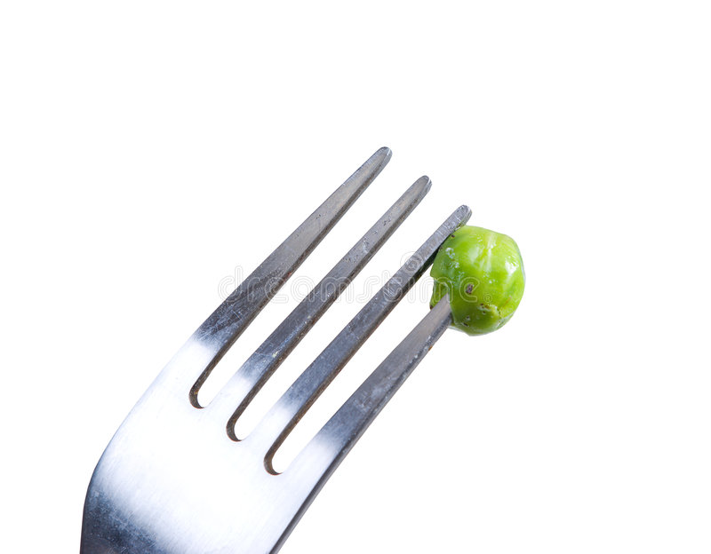 Green peas on fork royalty free stock photography