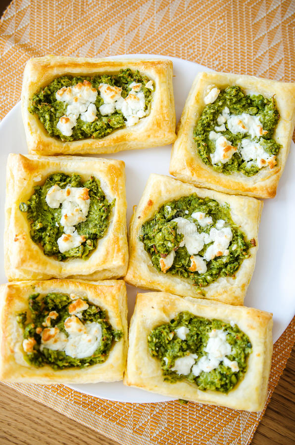 Green peas and goat cheese pastries stock image
