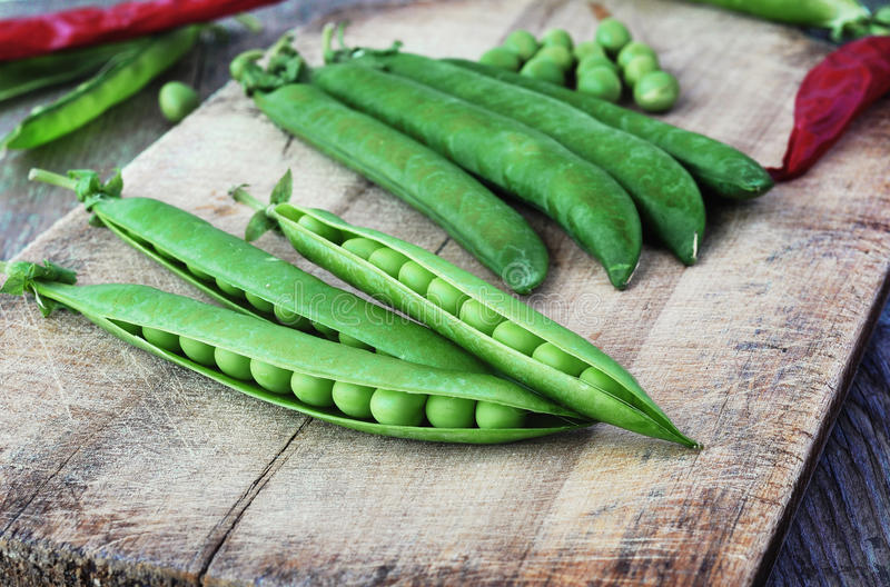 Green peas. Green peas on the wood backgraund stock photo