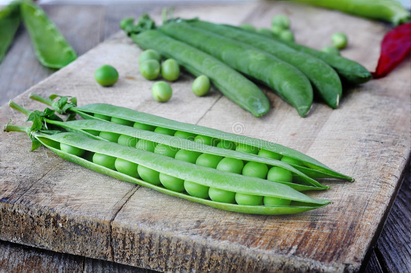 Green peas. Green peas on the wood backgraund royalty free stock photos