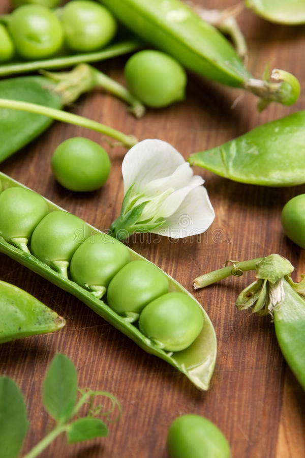 Download Green peas on wood board stock photo. Image of brown - 15906650