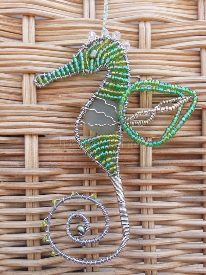 Handcraft seahorse wire and beads. stock photo